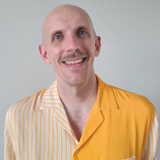 Adam Martel (he/him)